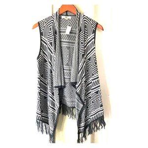 Sweater vest with fringe on bottom.